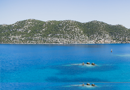 View of Simena bay in Turkey near sunken city with turqoise sea and mountains on background Stock Photo