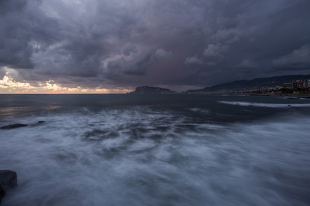 Alanya at sunset. Long exposure shot with dramatic clouds waves and storm on the sea. 版權商用圖片