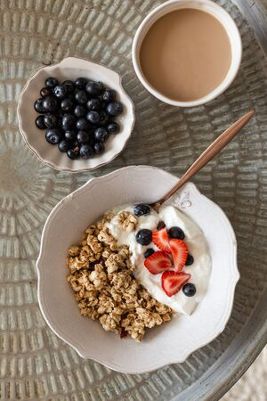 Healthy breakfast concept. Topview image of granola and coffee.