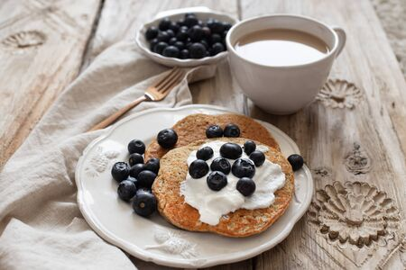 Healthy breakfast concept. Oatmeal pancakes topped with yogurt and blueberries. 版權商用圖片