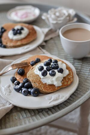 Healthy breakfast concept. Oatmeal pancakes topped with yogurt a