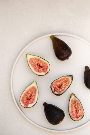 Figs on a round white plate