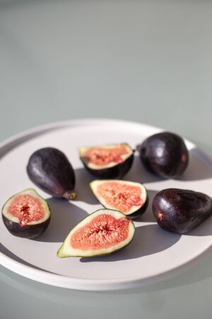 Figs on white ceramic plate.