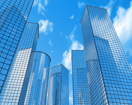 Six skyscrapers on a background of sky and clouds Stock Photo