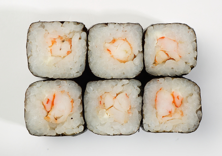 Rolls of Hosomaki with shrimp, top view, white background.