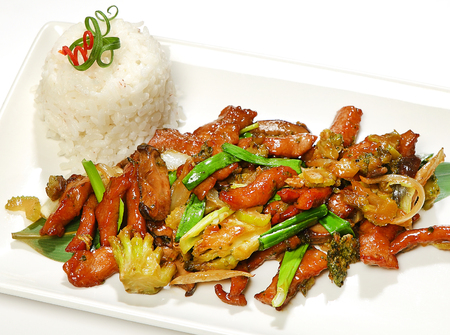 Pork Indonesian (pork with shiitake mushrooms, broccoli, celery, onions, sesame, oyster sauce, garnished with rice).