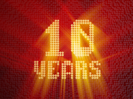 Golden number ten years (number 10 years) dotted font, top view, with light rays. 3D render