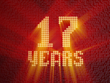 Golden number seventeen years (number 17 years) dotted font, top view, with light rays. 3D render