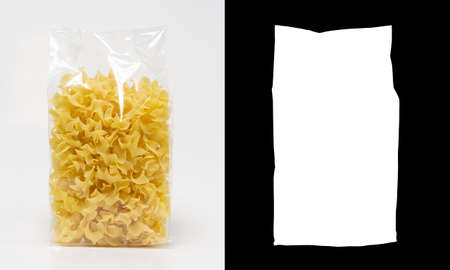 Transparent plastic pasta bag tagliatelle giratte on white background. With alpha channel