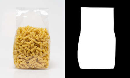 Transparent plastic pasta bag busiate on white background. With alpha channel