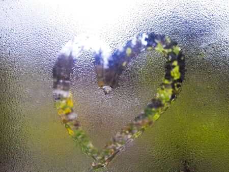 Drawed heart on wet glass