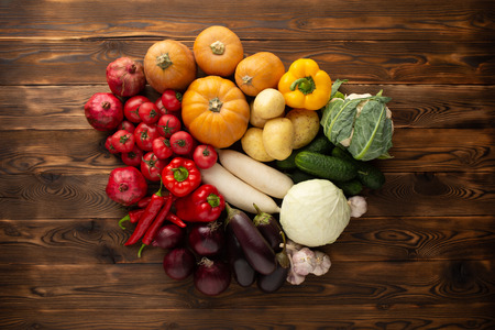 Vegetables on a brown wooden background 스톡 콘텐츠
