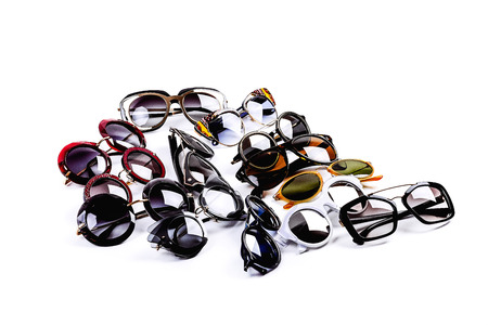 several sunglasses on a light background Stock Photo