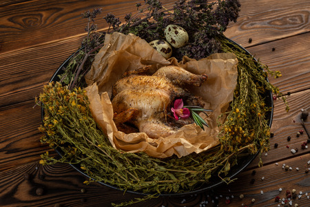 Mongolian chicken with herbs on wooden background