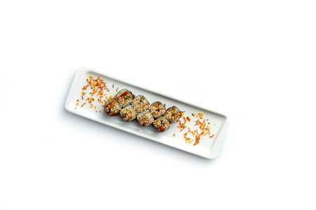 set sushi on a rectangular plate on an isolated white background Imagens