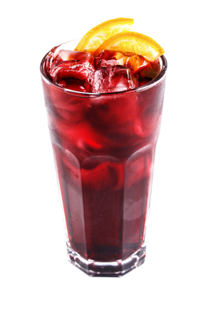 red cocktail with ice and orange in a tall glass on an isolated white background