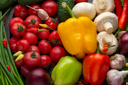 Fresh vegetables on a brown wooden background close-up