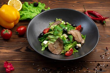 bifu sarada salad of tender slices of beef, feta cheese, cherry tomatoes and spinach leaves