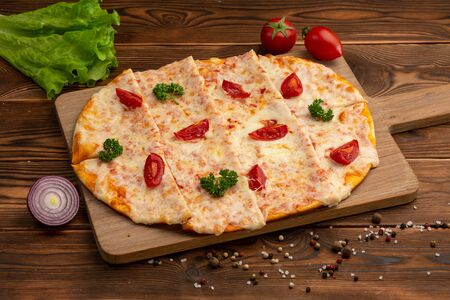 Asian pizza with sun-dried tomatoes, mozzarella and tartar sauce