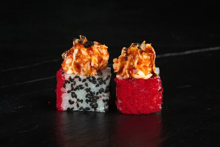 pair of sushi rolls chef de luxe close-up on a dark background Banco de Imagens