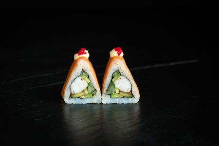 pair of sushi rolls fuji close-up on a dark background