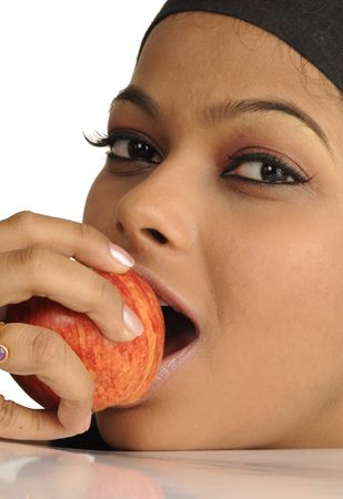Young girl eating apple Stock Photo - 6192681