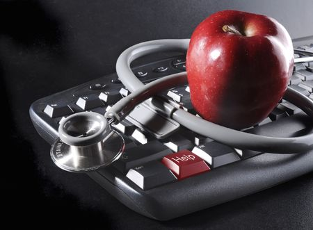 Apple and stethoscope on keyboard with HELP key photo