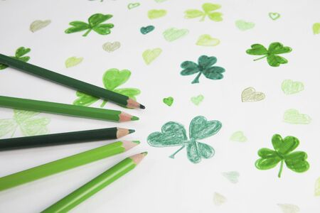 paddys: Shamrock drawing with green colouring pencils Stock Photo