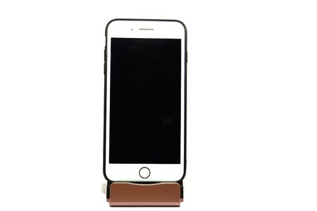 Mobile phone on a white background. Фото со стока