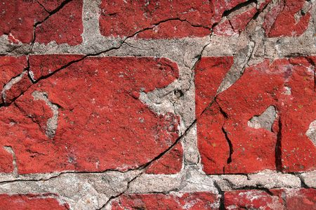 Cracked and old red brick wall photo
