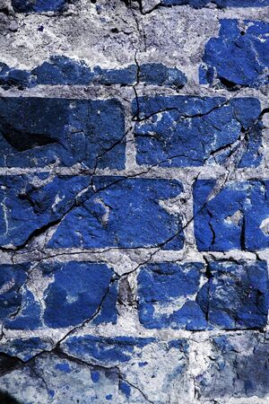 Cracked and dangerous blue brickwall photo