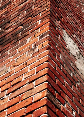 Cracked and dangerous brick wall photo