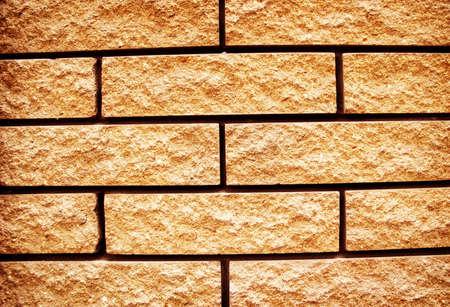 Yellow grunge texture of brick wall  photo