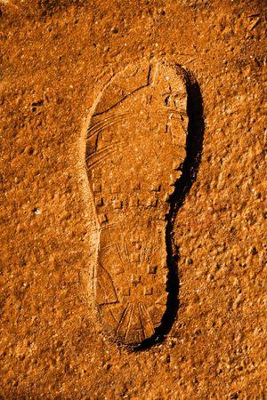 shoeprint: Fresh foot print on the sand