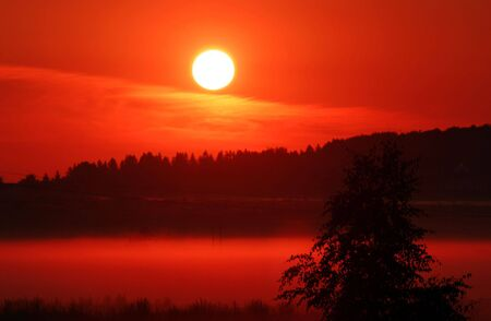 Red sunrise in the village photo