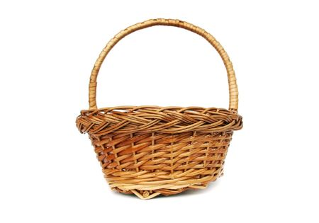 spliced: Brown willow basket for fruits isolated Stock Photo