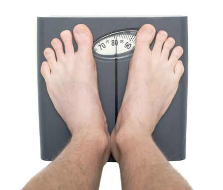 Men on bathroom scale isolated photo