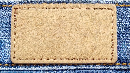 Yellow label on blue jeans photo