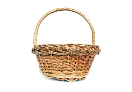 Brown willow basket for fruits isolated photo