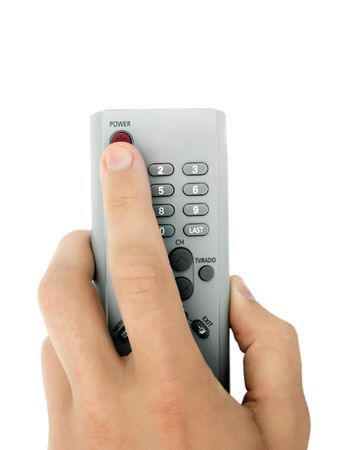 Isolated remote control in the hand photo