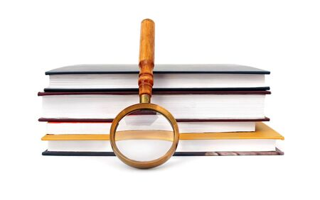 Old style magnifying glass isolated on white photo