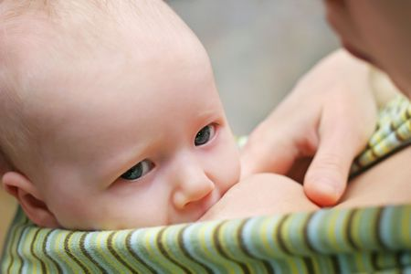 Mother breast feeding her baby Stock Photo - 6785034