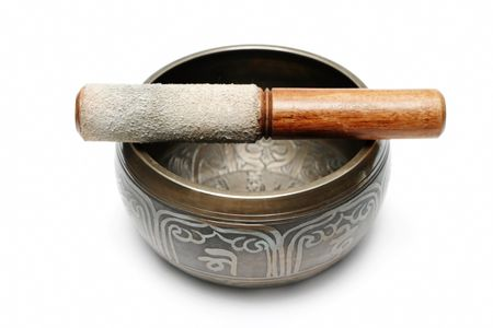 Tibetan singing bowl isolated on white photo