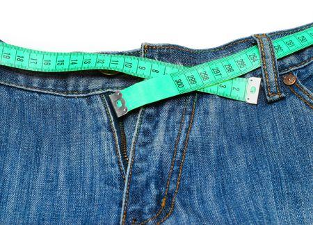 decreasing in size: misurazione nastro intorno womans pantaloni Archivio Fotografico