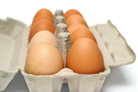 Egg box isolated on white photo