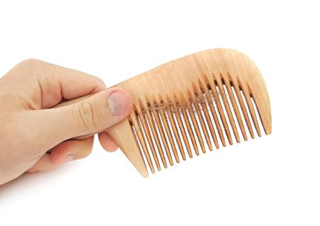 hair problem: Comb in the hand with loss hair Stock Photo