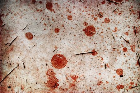 Blood spots on cracked background photo