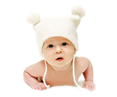 Newborn baby in the cap isolated photo
