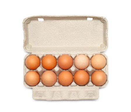 Eggs in the box isolated on white photo