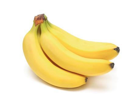 Ripe bananas bunch isolated on white photo